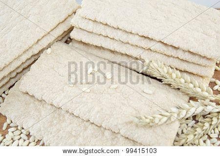 Integral Biscuit Plates Stacked On A Wooden Table Decorated With Sesame And Wheat