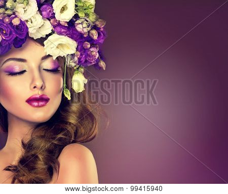 Beauty model girl with colorful flowers hairstyle