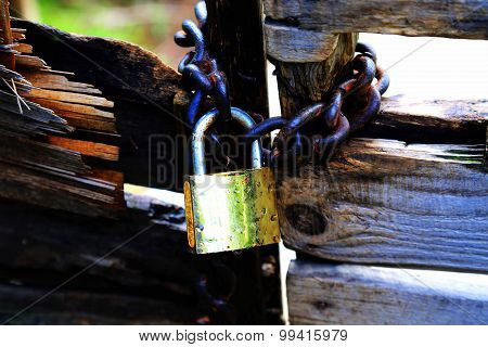 Locking up a Rotten Wood Door with an Old Lock and Chain