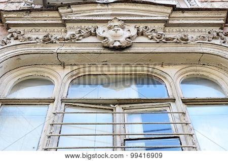 Sculptural decoration of window on facade of an old apartment building in Tbilisi, Georgia
