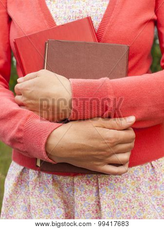 The Woman Is Holding Book.
