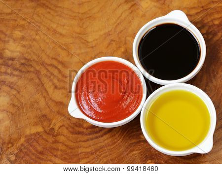 traditional Italian sauces - balsamic vinegar, tomato sauce and olive oil