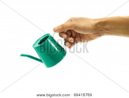 hand holding watering can isolated on white background.