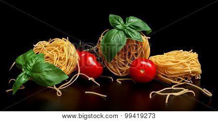 Group Of Three Round Balls Of Raw Pasta On Black