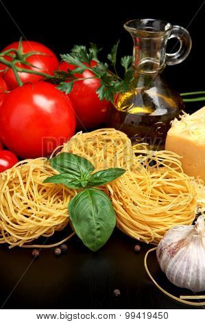 Round Balls Of Pasta With Cheese, Tomatoes,basil,olive Oil On Black