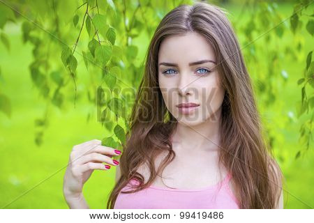 Close up Portrait, Young beautiful brunette woman posing outdoors in sunny weather