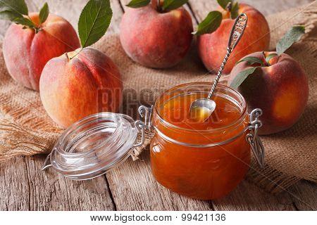 Fresh Homemade Peach Jam In A Glass Jar Close-up. Horizontal