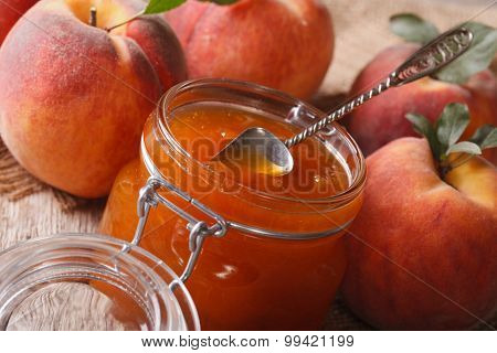 Peach Jam In A Glass Jar Close Up On The Table. Horizontal