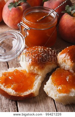 Delicious Buns With Peach Jam Close-up On The Table. Vertical