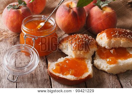 Homemade Buns With Peach Jam Close-up On The Table. Horizontal