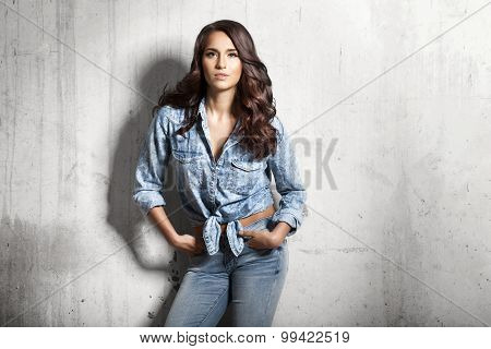 Young Woman In Jeans And A Denim Shirt