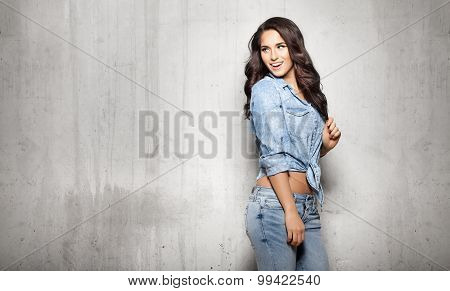 Attractive Woman In Jeans Touching Her Hair