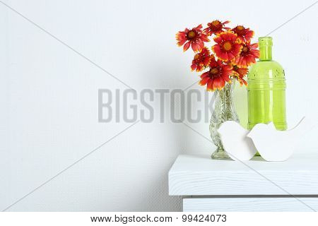 Beautiful flowers with decorative birds on wall background