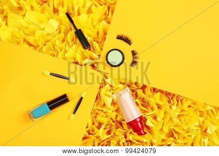 Cosmetic on colorful paper background