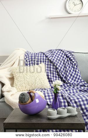 Knitting thread in basket  on living room interior background