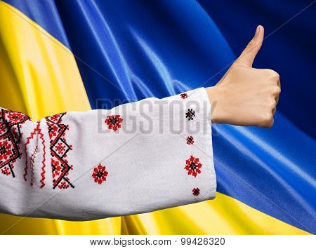 Woman In Ukrainian Clothes Shows Symbol Ok Against Ukrainian Flag
