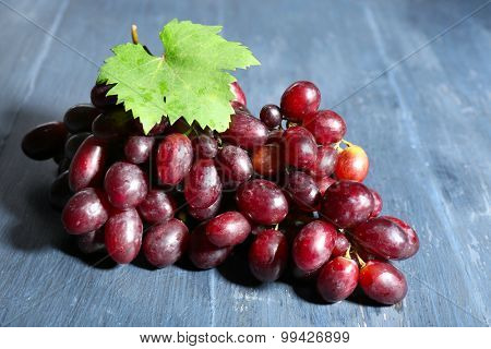 Fresh ripe grapes on wooden table