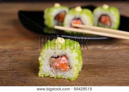 Rolls with sticks on wooden table close up