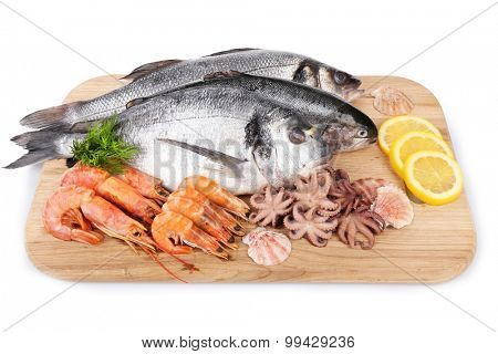 Seafood collection on wooden cutting board isolated on white