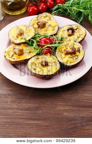 Baked potatoes with cheese and mushrooms on table close up