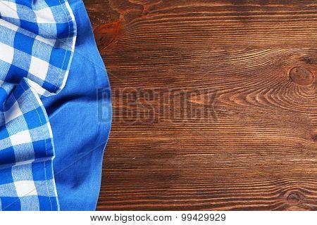 Napkin on wooden background