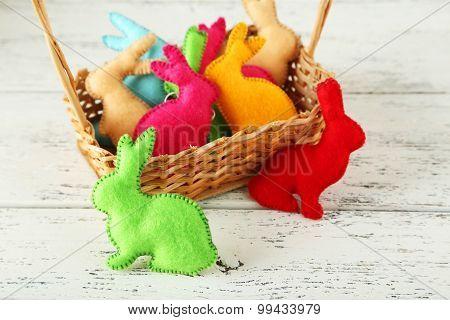 Handmade Easter Rabbits On White Wooden Background