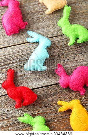 Handmade Easter Rabbits On Grey Wooden Background