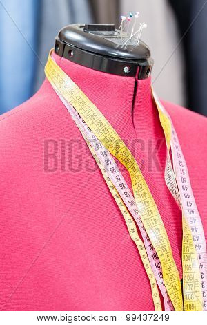 Mannequin With Measure Tapes And Ready Dresses