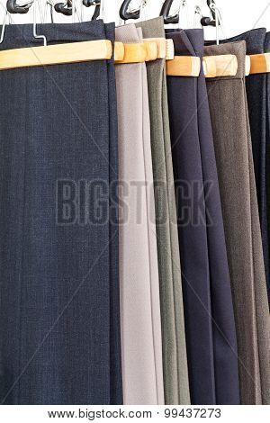 Various Woolen Trousers On Hangers