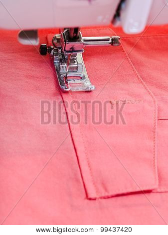 Attaching Pocket To Red Blouse On Sewing Machine
