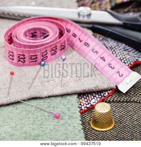 Pink Measure Tape, Pins, Thimble, Shears On Tissue