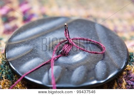 Attaching Of Button To Woolen Dress By Needle