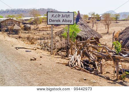 Road Sign To Derek Abay Village In Ethiopia.