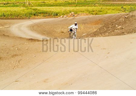 The Man Wiyh A Bicycle On The Road In Sudan