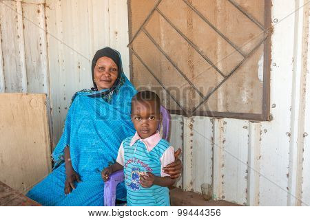 Sudanese Mother With The Child