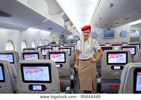 HONG KONG - MARCH 10, 2015: Emirates Airbus A380 crew member. Emirates handles major part of passenger traffic and aircraft movements at the airport.