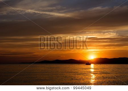Cloudy sky at sunset over sea