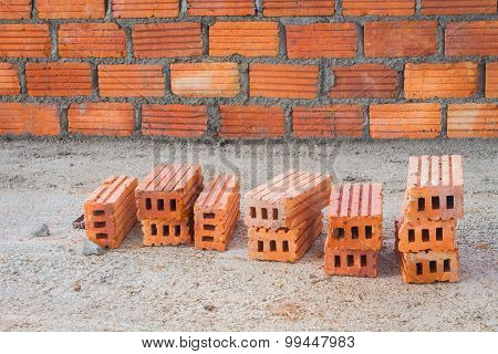 Red Bricks In Front Of Brick Wall, Focusing On The Bricks In Front.