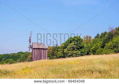 Ukrainian Wooden Windmill Windmill Stands Near A Forest In The Field