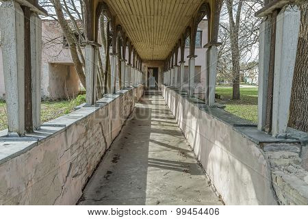 Damaged And  Long Corridor To The Building