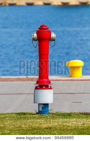 Red fire hydrant in the port.