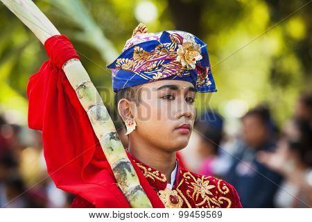 Portrait Of Balinese Young Man In Traditional Costume