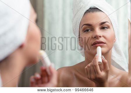 Woman Applying Protective Lipstick