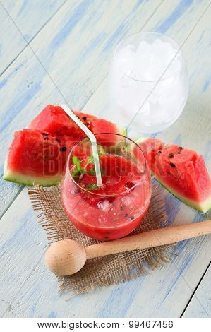 Glass Of Melon Smoothie And Glass Of Ice