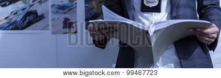 Policewoman Holding Book
