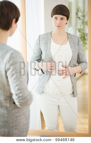 Dressing Up Pregnant Woman