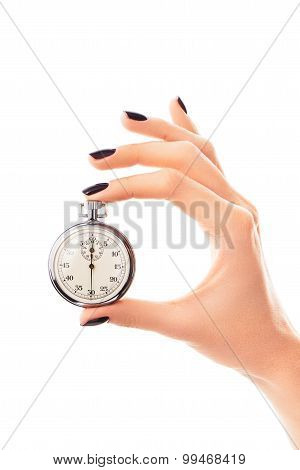 Female hand holding stopwatch set to thirty seconds with nails covered with black nail polish