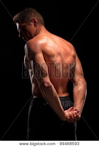 Sexy male muscular shirtless sportsman demonstrating back pectoral abs triceps muscles