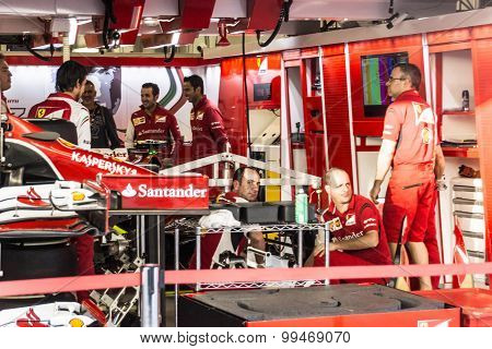 The Scuderia Ferrari Team. Mechanics Prepare The Car Of Kimi Raikkonen.
