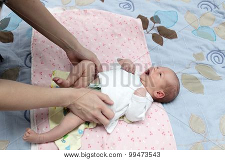 Mother Changes Diapers
